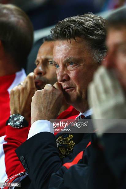 Manager Louis van Gaal of Manchester United despairs with assistant Ryan Giggs during the Capital One Cup Second Round match between MK Dons and...
