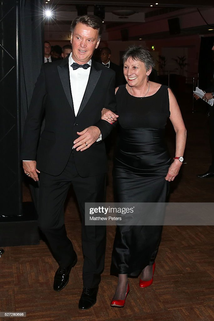 Manager Louis van Gaal of Manchester United escorts auction winner Ivy Roe into the room at the club's annual Player of the Year awards at Old Trafford on May 2, 2016 in Manchester, England.