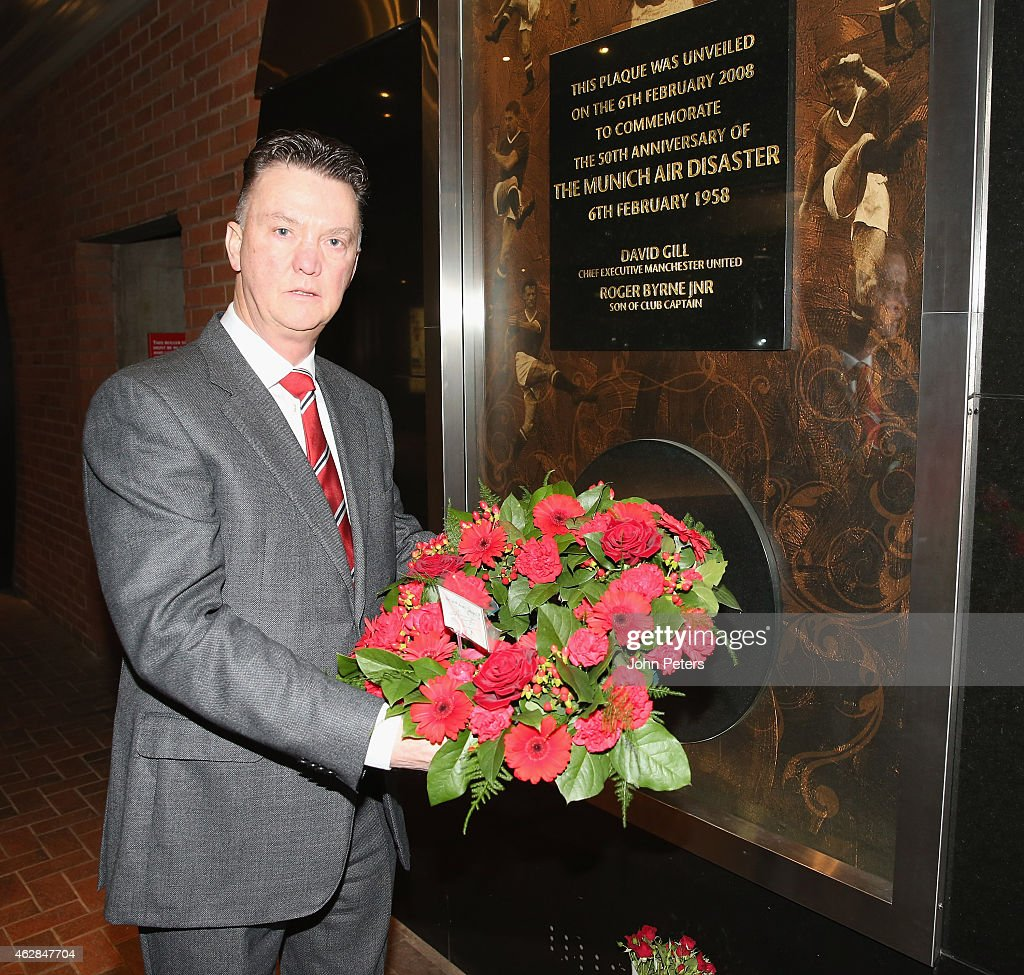 Manager Louis van Gaal of Manchester United lays a wreath the Munich Air Disaster memorial to remember the 21 people killed on 6 February 1958, including 8 Manchester United players, 3 club staff and 8 journalists, at Old Trafford on February 6, 2015 in Manchester, England.