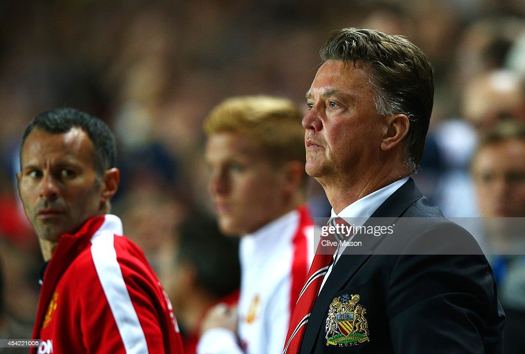 Manager Louis van Gaal of Manchester United looks dejected with assistant Ryan Giggs (L) after the Capital One Cup Second Round match between MK Dons and Manchester United at Stadium mk on August 26, 2014 in Milton Keynes, England.