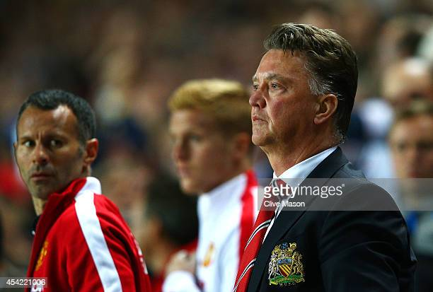 Manager Louis van Gaal of Manchester United looks dejected with assistant Ryan Giggs after the Capital One Cup Second Round match between MK Dons and...