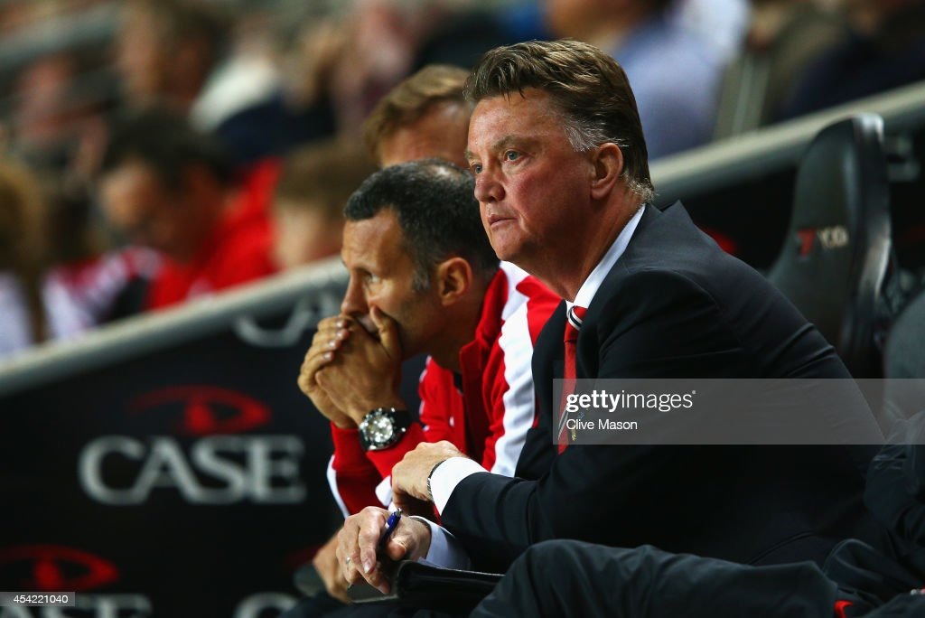 Manager Louis van Gaal of Manchester United looks dejected with assistant Ryan Giggs during the Capital One Cup Second Round match between MK Dons and Manchester United at Stadium mk on August 26, 2014 in Milton Keynes, England.