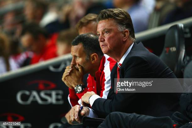 Manager Louis van Gaal of Manchester United looks dejected with assistant Ryan Giggs during the Capital One Cup Second Round match between MK Dons...