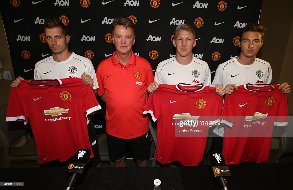 Manager Louis van Gaal of Manchester United poses with his new signings ahead of a press conference to unveil <a gi-track='captionPersonalityLinkClicked' href=/galleries/search?phrase=Bastian+Schweinsteiger&family=editorial&specificpeople=203122 ng-click='$event.stopPropagation()'>Bastian Schweinsteiger</a>, <a gi-track='captionPersonalityLinkClicked' href=/galleries/search?phrase=Morgan+Schneiderlin&family=editorial&specificpeople=4191360 ng-click='$event.stopPropagation()'>Morgan Schneiderlin</a> and <a gi-track='captionPersonalityLinkClicked' href=/galleries/search?phrase=Matteo+Darmian&family=editorial&specificpeople=7096006 ng-click='$event.stopPropagation()'>Matteo Darmian</a> as the club's new signings on July 15, 2015 in Seattle, Washington.
