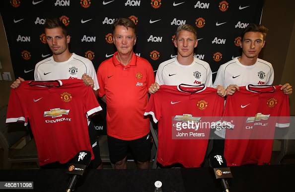 Manager Louis van Gaal of Manchester United poses with his new signings ahead of a press conference to unveil Bastian Schweinsteiger Morgan...