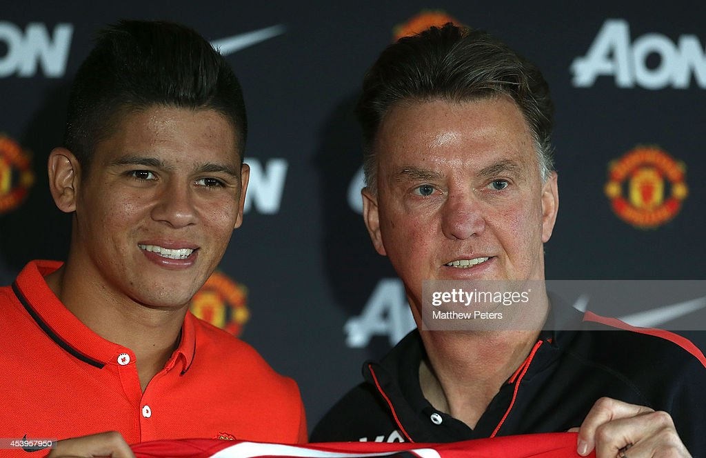 Manager Louis van Gaal of Manchester United poses with <a gi-track='captionPersonalityLinkClicked' href=/galleries/search?phrase=Marcos+Rojo&family=editorial&specificpeople=6740047 ng-click='$event.stopPropagation()'>Marcos Rojo</a> after a press conference to unveil new signing <a gi-track='captionPersonalityLinkClicked' href=/galleries/search?phrase=Marcos+Rojo&family=editorial&specificpeople=6740047 ng-click='$event.stopPropagation()'>Marcos Rojo</a> at Aon Training Complex on August 22, 2014 in Manchester, England.