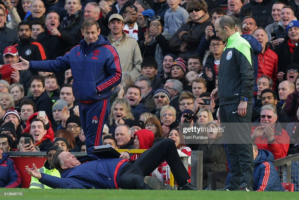 Manager Louis van Gaal of Manchester United remonstrates with the fourth official Mike Dean during the Barclays Premier League match between Manchester United and Arsenal at Old Trafford on February 28 2016 in Manchester, England.