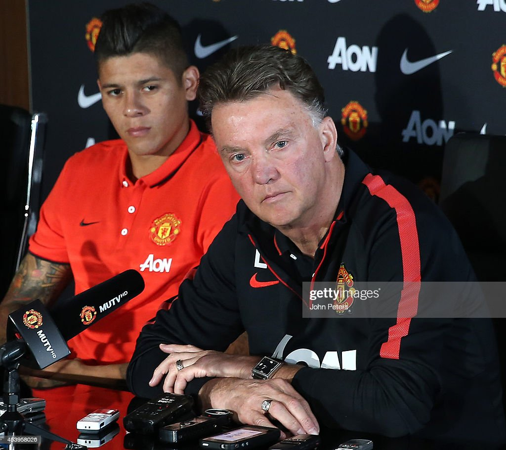 Manager Louis van Gaal of Manchester United speaks at a press conference to unveil new signing <a gi-track='captionPersonalityLinkClicked' href=/galleries/search?phrase=Marcos+Rojo&family=editorial&specificpeople=6740047 ng-click='$event.stopPropagation()'>Marcos Rojo</a> at Aon Training Complex on August 22, 2014 in Manchester, England.
