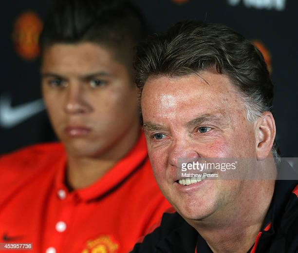 Manager Louis van Gaal of Manchester United speaks during a press conference to unveil new signing Marcos Rojo at Aon Training Complex on August 22...