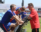 Manager Louis van Gaal of Manchester United talks to Bastian Schweinsteiger during a first team training session as part of their preseason tour of...