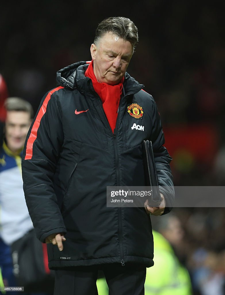 Manager Louis van Gaal of Manchester United walks off after the FA Cup Quarter Final match between Manchester United and Arsenal at Old Trafford on March 9, 2015 in Manchester, England.