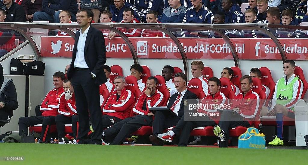 Manager Louis van Gaal of Manchester United watches from the dugout during the Barclays Premier League match between Sunderland and Manchester United at Stadium of Light on August 24, 2014 in Sunderland, England.
