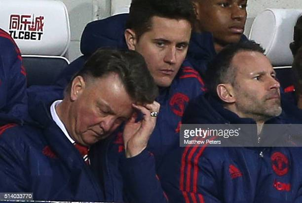 Manager Louis van Gaal of Manchester United watches from the dugout during the Barclays Premier League match between West Bromwich Albion and...