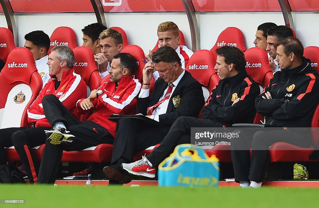 Manager Louis van Gaal reacts with assistant Ryan Giggs of Manchester United on the bench during the Barclays Premier League match between Sunderland and Manchester United at Stadium of Light on August 24, 2014 in Sunderland, England.