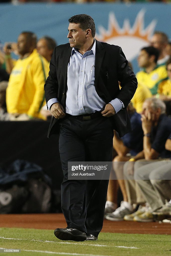 Manager <a gi-track='captionPersonalityLinkClicked' href=/galleries/search?phrase=Luis+Fernando+Suarez+-+Soccer+Coach&family=editorial&specificpeople=548216 ng-click='$event.stopPropagation()'>Luis Fernando Suarez</a> of Honduras looks on during first half action against Brazil on November 16, 2013 during a friendly match at SunLife Stadium Stadium in Miami Gardens, Florida. Brazil defeated Honduras 5-0.