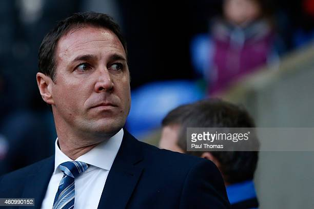 Manager Malky Mackay of Wigan watches on during the FA Cup Third Round match between Bolton Wanderers and Wigan Athletic at the Macron Stadium on...