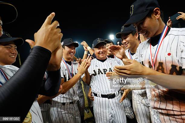Manager Mamoru Koeda is congratulated by players of Japan after the final game between Japan and Taiwan during the 11th BFA U18 Baseball Championship...