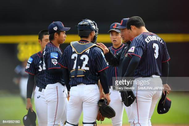 Manager Mamuro Koeda of Japan speaks to his team during the second inning of a game against Korea during the WBSC U18 Baseball World Cup Super Round...
