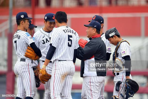 Manager Mamuro Koeda of Japan speaks with his team during the tenth inning of a game against Australia during the WBSC U18 Baseball World Cup Super...