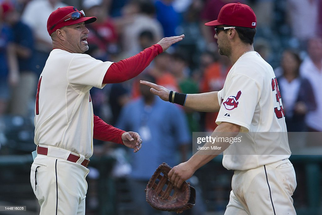 Manager <a gi-track='captionPersonalityLinkClicked' href=/galleries/search?phrase=Manny+Acta&family=editorial&specificpeople=534537 ng-click='$event.stopPropagation()'>Manny Acta</a> #11 celebrates with <a gi-track='captionPersonalityLinkClicked' href=/galleries/search?phrase=Casey+Kotchman&family=editorial&specificpeople=240573 ng-click='$event.stopPropagation()'>Casey Kotchman</a> #35 of the Cleveland Indians after defeating the against the Miami Marlins at Progressive Field on May 19, 2012 in Cleveland, Ohio. The Indians defeated the Marlins 2-0.
