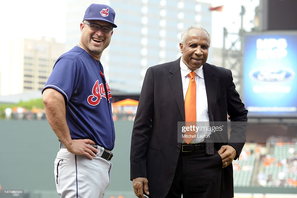 Manager <a gi-track='captionPersonalityLinkClicked' href=/galleries/search?phrase=Manny+Acta&family=editorial&specificpeople=534537 ng-click='$event.stopPropagation()'>Manny Acta</a> #11 of the Cleveland Indians and former player <a gi-track='captionPersonalityLinkClicked' href=/galleries/search?phrase=Frank+Robinson&family=editorial&specificpeople=167022 ng-click='$event.stopPropagation()'>Frank Robinson</a> talk before a baseball game against the Baltimore Orioles at Oriole Park at Camden Yards on June 30, 2012 in Baltimore, Maryland.
