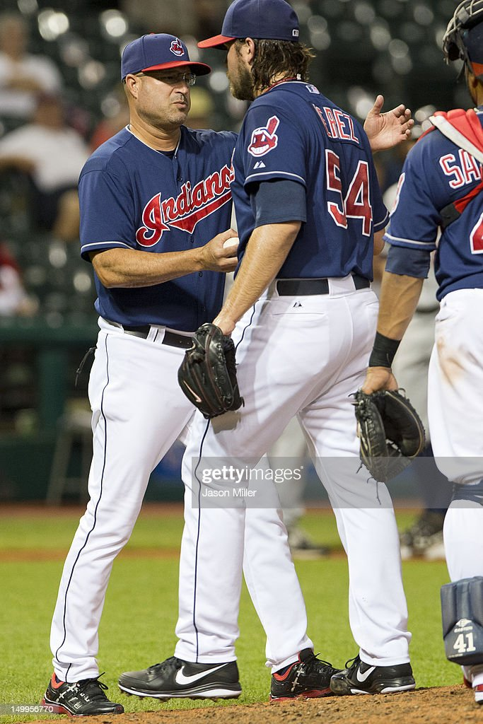 Manager Manny Acta #11 removes pitcher Chris Perez #54 of the Cleveland Indians from the game after Perez gave up the lead during the ninth inning against the Minnesota Twins at Progressive Field on August 7, 2012 in Cleveland, Ohio.
