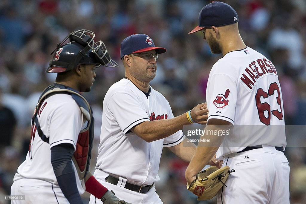 Manager <a gi-track='captionPersonalityLinkClicked' href=/galleries/search?phrase=Manny+Acta&family=editorial&specificpeople=534537 ng-click='$event.stopPropagation()'>Manny Acta</a> #11 takes starting pitcher <a gi-track='captionPersonalityLinkClicked' href=/galleries/search?phrase=Justin+Masterson&family=editorial&specificpeople=4950538 ng-click='$event.stopPropagation()'>Justin Masterson</a> #63 of the Cleveland Indians out of the game during the fifth inning against the Tampa Bay Rays at Progressive Field on July 6, 2012 in Cleveland, Ohio.