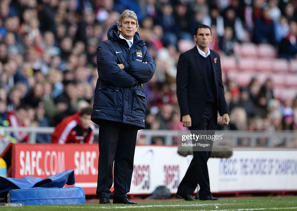 Manager Manuel Pellegrini (L) and Manager Gus Poyet look on during the Barclays Premier League match between Sunderland and Manchester City at the Stadium of Light on November 10, 2013 in Sunderland, England.