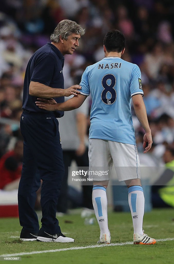 Manager Manuel Pellegrini of Manchester City has a word with Samir Nasri during the friendly match between Al Ain and Manchester City at Hazza bin Zayed Stadium on May 15, 2014 in Al Ain, United Arab Emirates.