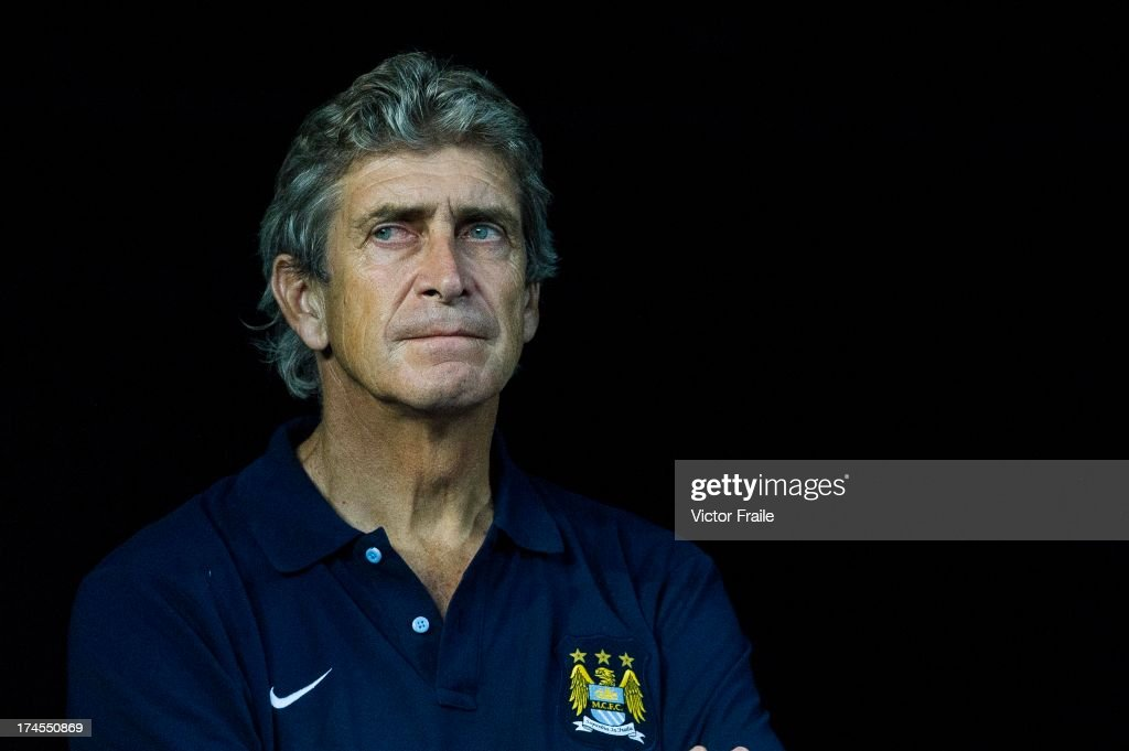 Manager <a gi-track='captionPersonalityLinkClicked' href=/galleries/search?phrase=Manuel+Pellegrini&family=editorial&specificpeople=673553 ng-click='$event.stopPropagation()'>Manuel Pellegrini</a> of Manchester City looks before the Barclays Asia Trophy Final match between Manchester City and Sunderland at Hong Kong Stadium on July 27, 2013 in So Kon Po, Hong Kong.