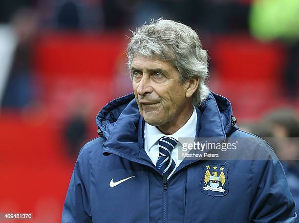 Manager Manuel Pellegrini of Manchester City walks off after the Barclays Premier League match between Manchester United and Manchester City at Old...