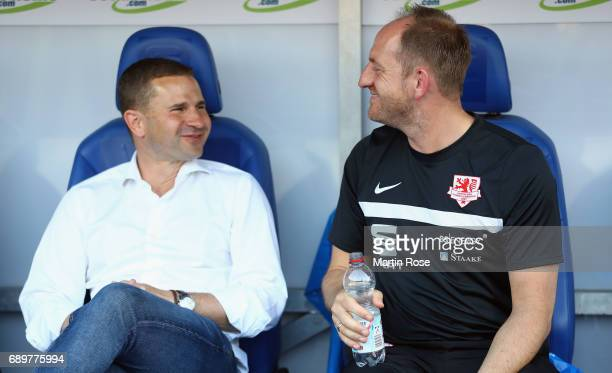 Manager Marc Arnold and head coach Torsten Lieberknecht of Braunschweig chat prior to the Bundesliga Playoff leg 2 match between Eintracht...