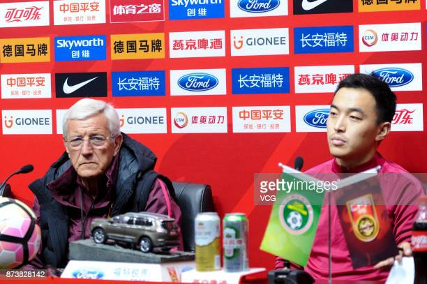 Manager Marcello Lippi and player Feng Xiaoting of China attend a press conference before an international friendly football match between China and...