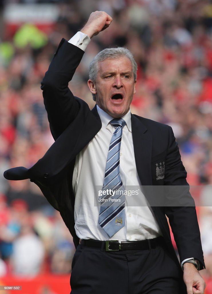 Manager Mark Hughes of Manchester City celebrates Craig Bellamy scoring their third goal during the FA Barclays Premier League match between Manchester United and Manchester City at Old Trafford on September 20 2009 in Manchester, England.