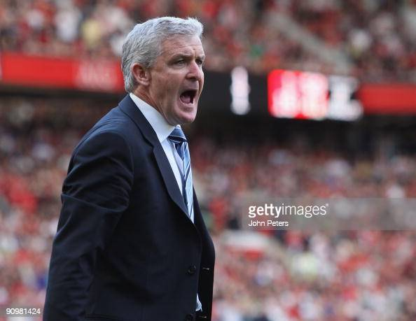 Manager Mark Hughes of Manchester City complains to the fourth official during the FA Barclays Premier League match between Manchester United and...