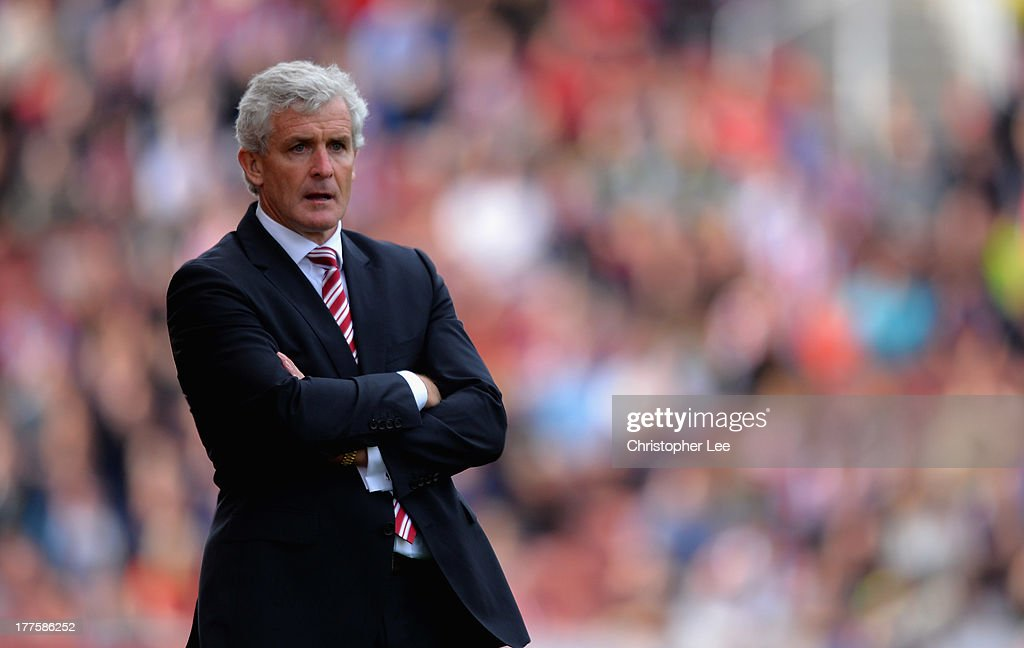 Manager Mark Hughes of Stoke City concentrates on the game during the Barclays Premier League match between Stoke City and Crystal Palace at Britannia Stadium on August 24, 2013 in Stoke on Trent, England.