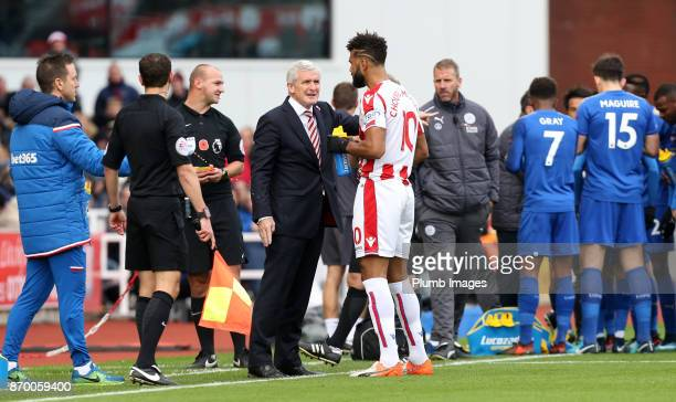 Manager Mark Hughes of Stoke City gives instructions to Maxim ChoupoMoting of Stoke City during the Premier League match between Stoke City and...