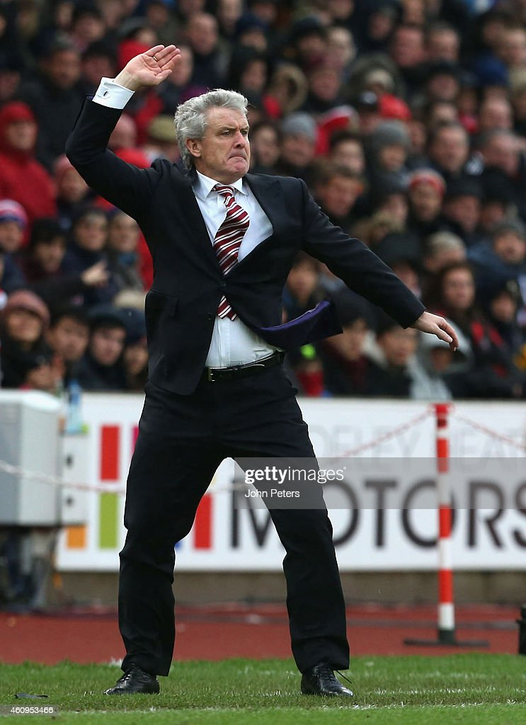 Manager Mark Hughes of Stoke City watches from the touchline during the Barclays Premier League match between Stoke City and Manchester United at Britannia Stadium on January 1, 2015 in Stoke on Trent, England.