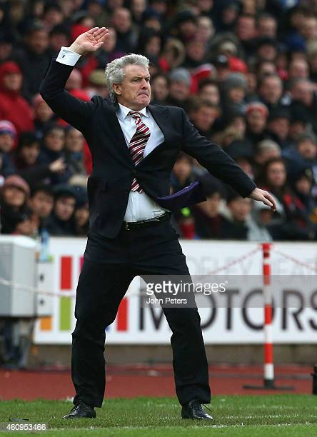 Manager Mark Hughes of Stoke City watches from the touchline during the Barclays Premier League match between Stoke City and Manchester United at...