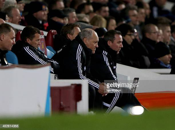 Manager Martin Jol of Fulham and coach Rene Meulensteen look thoughtful during the Barclays Premier League match between West Ham United and Fulham...