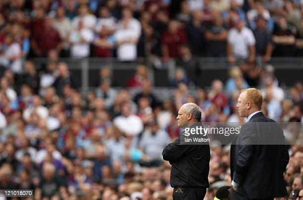 Manager Martin Jol of Fulham and Manager Alex McLeish of Aston Villa look on during the Barclays Premier League match between Fulham and Aston Villa...