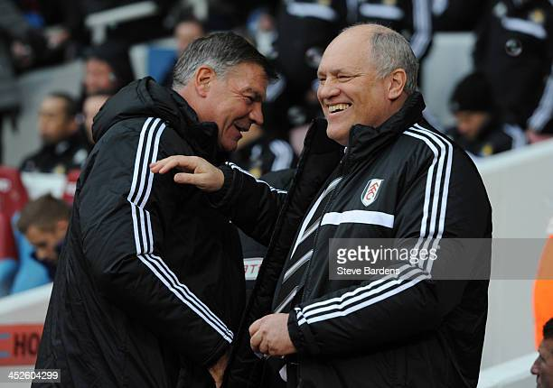 Manager Martin Jol of Fulham shares a joke with manager Sam Allardyce of West Ham United before the Barclays Premier League match between West Ham...