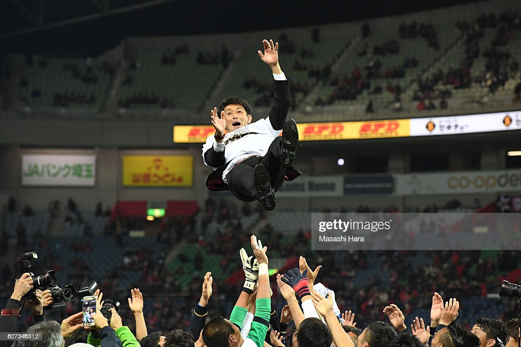 Manager Masatada Ishii of Kashima Antlers is tossed into the air by players after winning the J.League Championship after the J.League Championship Final second leg match between Urawa Red Diamonds and Kashima Antlers at Saitama Stadium on December 3, 2016 in Saitama, Japan.