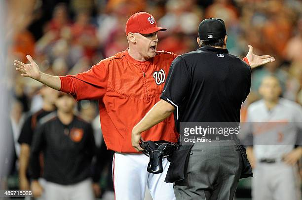 Manager Matt Williams of the Washington Nationals argues with home plate umpire Mark Ripperger after Jonathan Papelbon was thrown out of the game in...