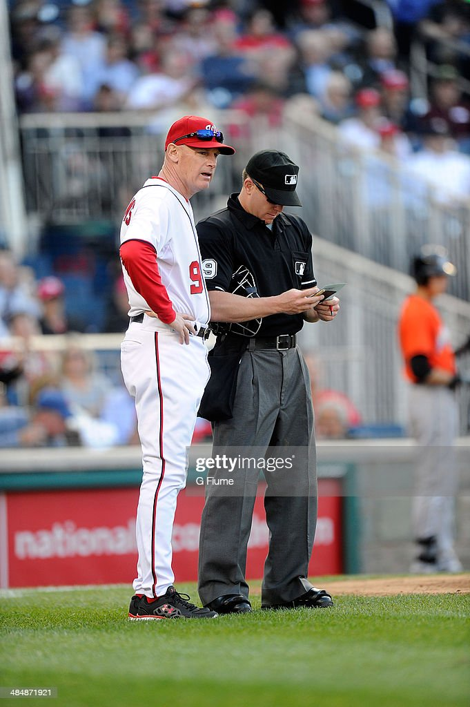 Manager Matt Williams #9 of the Washington Nationals talks with home plate umpire D.J. Reyburn #70 during the game against the Miami Marlins at Nationals Park on April 10, 2014 in Washington, DC.