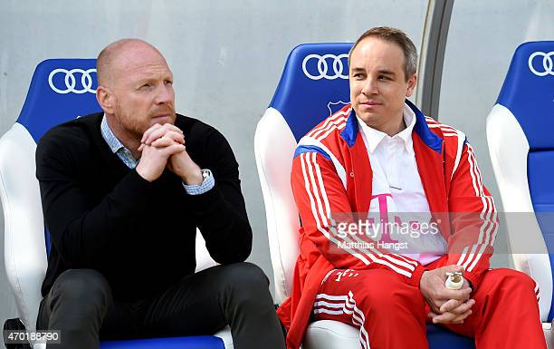 Manager Matthias Sammer of Munich talks to Doctor Volker Braun new club doctor of Muenchen during the Bundesliga match between 1899 Hoffenheim and FC...