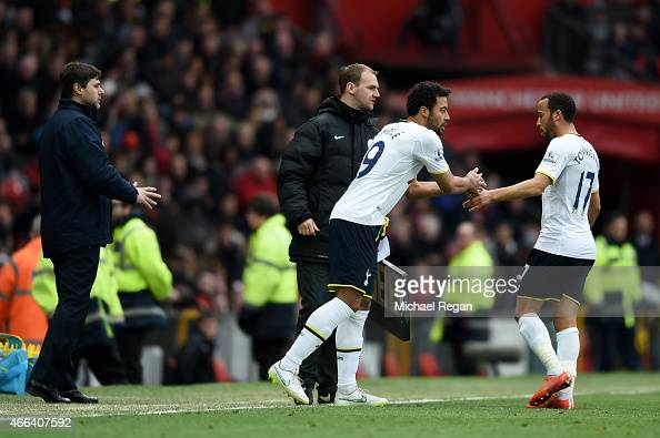Manager Mauricio Pochettino of Spurs sends on Mousa Dembele of Spurs as a first half substitute for the beleaguered Andros Townsend of Spurs during...