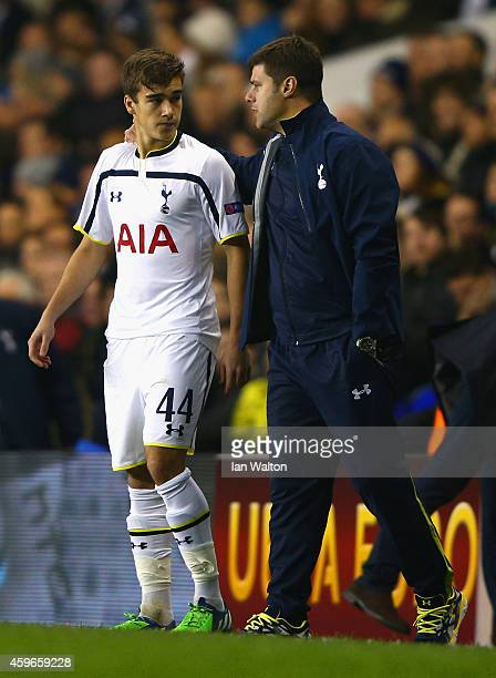 Manager Mauricio Pochettino of Spurs speaks to Harry Winks of Spurs as he prepares to come on as a substitute during the UEFA Europa League group C...