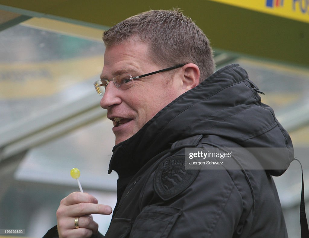 Manager Max Eberl of Moenchengladbach holds a lolly in his hand at the Bundesliga match between Borussia Moenchengladbach and VfB Stuttgart at Borussia Park Stadium on November 17, 2012 in Moenchengladbach, Germany.