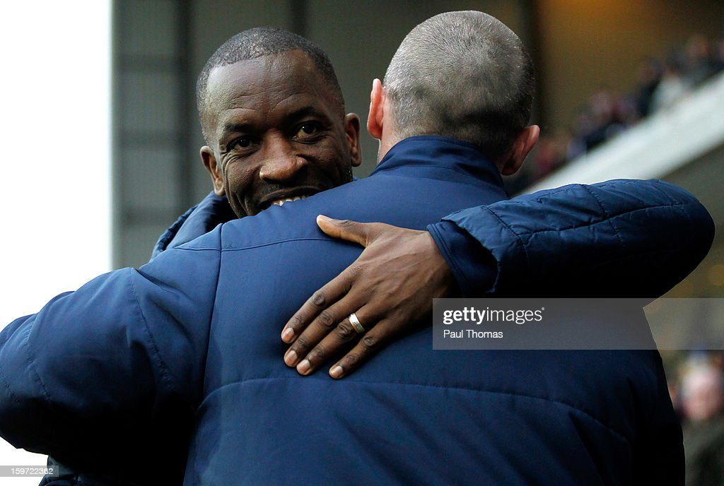 Manager Michael Appleton of Blackburn is hugged by Manager Chris Powell (L) of Charlton before the npower Championship match between Blackburn Rovers and Charlton Athletic at Ewood Park on January 19, 2013 in Blackburn, England.